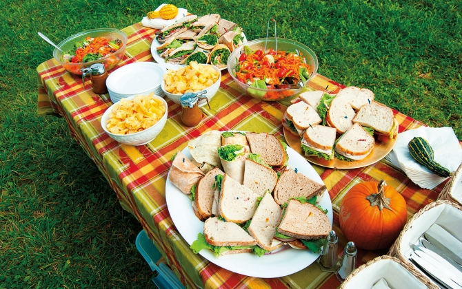 set picnic table with assorted foods