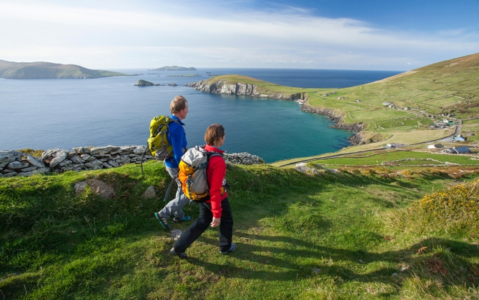 hikers along the coast of ireland