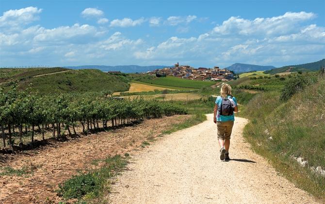 woman walking on a dirt trail in spain
