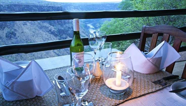 dinner table overlooking valley and river