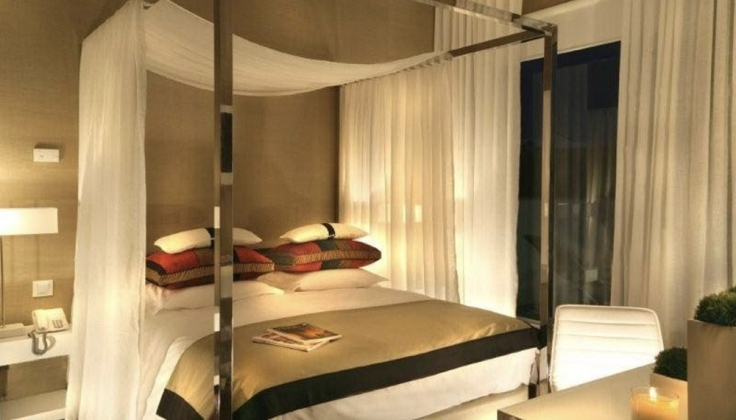 Aqueduto Hotel and Spa bedroom with four post bed