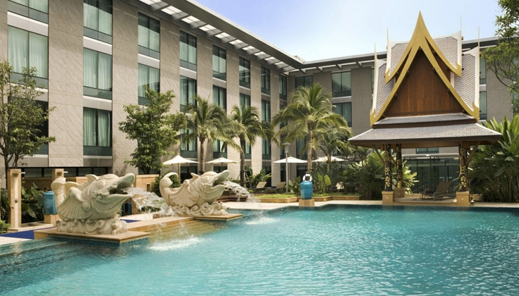 The hotel exterior pool, with large fish statues acting as fountains