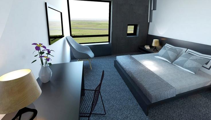a spartan hotel bedroom