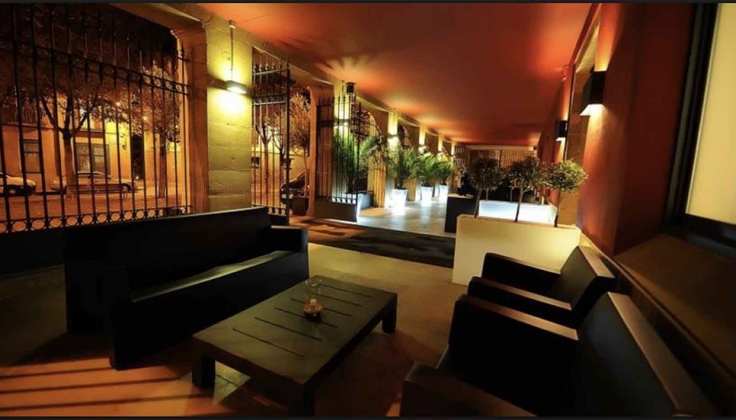 Hotel Pamplona covered outdoor lounge at night