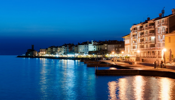 Hotel Piran at night from across the water