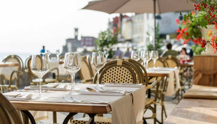 Hotel Piran restaurant terrace with wine glasses on the tables