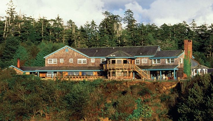 hotel lodge exterior with pine trees in the background