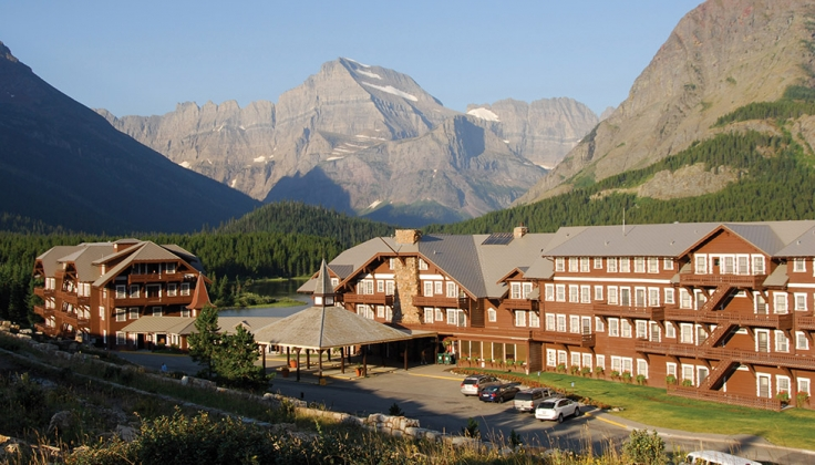 Glacier Hotel lodge exterior with mountains surrounding it