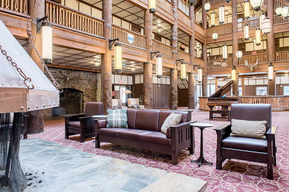 spacious Glacier Lodge lobby area with moose head hanging on wall in the background