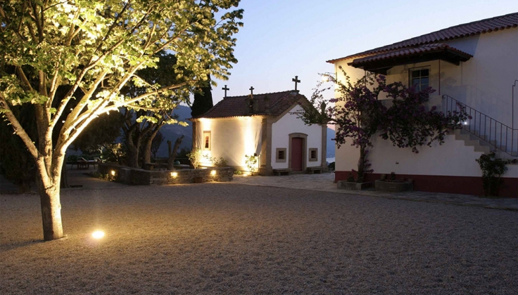 spanish style villa exterior gravel courtyard at dusk