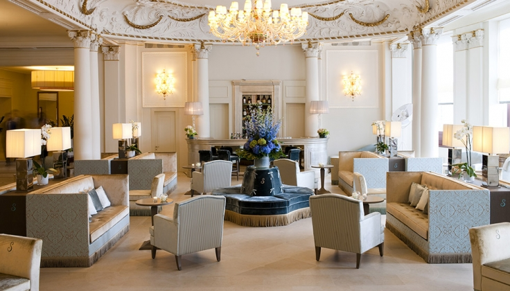 an elegant hotel lobby and lounge area