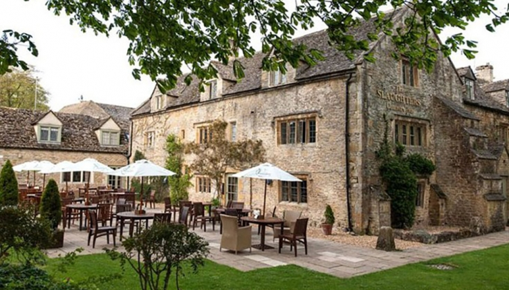 Slaughters Country Inn exterior with courtyard dining area
